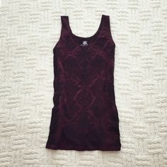 Stretchy Tank In excellent condition. 47% polyester, 46% nylon, 7% spandex.  Black and dark burgundy color.  No trades.  {#10124} Rock & Republic Tops Tank Tops