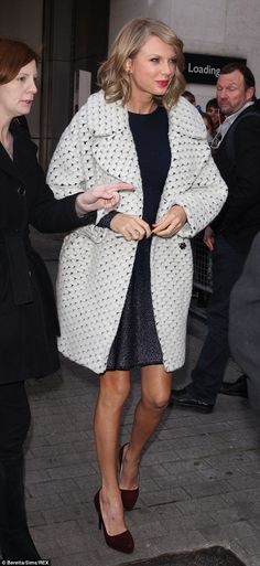 Beautiful: Swift topped her look with a luxurious knitted white boyfriend style coat...