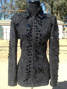 This is by Lindsey James. Black base jacket with black lace applique and black acrylic accents, so simple and so effective!