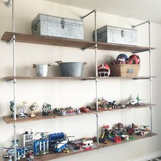 "Here's a little peek at the DIY industrial shelves my husband made for our 11 year old son. Since this is the last week of #projectvignette and it's all about the #shelfie I wanted to show a kid's space. Mommas of boys, can we say Lego mania goes on in the house and my son needed a place to ""display"" all of his creations. Now the legos no longer line his walls at risk of being sucked up by the vacuum {no, that never happens!} He's also a big sports kid and has trophies for each season that…"