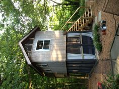 Tiny house with screened porch below. It's like a treehouse