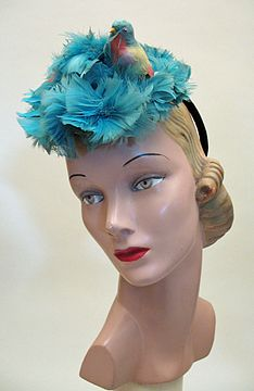 1940s Vintage Tilt Hat ofdyed blue feathers with Perched Bird and circle clamp.