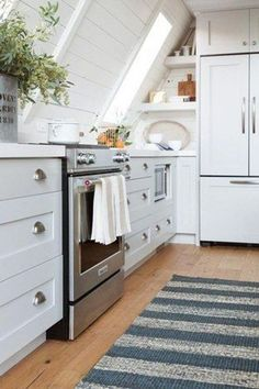 We've rounded up a few of our favorite attic kitchen ideas that are sure to inspire. Take a look. #hunkerhome #attic #atticideas #attickitchen #attickitchen Pink Accent Walls, Kitchen Renovation Inspiration, Berlin Apartment, Tan Sofa, Wood Columns, Striped Towels, Studio Mcgee, Black Cabinets, Counter Stools