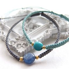 It is the bracelet of a turquoise cut by a coin type.  It is knit with a nylon cord beautifully.  The turquoise has a stone named the divine nature and