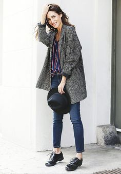 Gala Gonzalez wears a printed coat with a striped blouse, skinny jeans, black brogues and a felt hat.