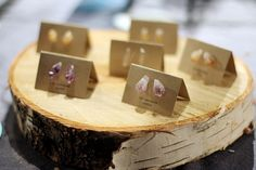 WOW!!! love the simple backings, the earrings themselves, the print underneath, and the birch display.  City of Craft by Elena Kovyrzina, via Flickr