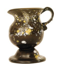 10cm high nailsea creamer with yellow spots.
