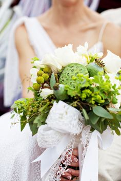 Green and white bridal bouquet by Lavender Green. Photo by Katie Stoops. #wedding  See more here: http://www.bellwetherevents.com/