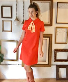 Totally mod, baby! This bright orange 60s shift dress features a collar, attached white and orange floral silk scarf, a skirt that is nearly knee length, and short sleeves.  Measurements make the dress a size 8. Meant to fit loosely in some areas as its a shift dress.  Great vintage condition, no damage other than some slight fraying at both ends of the accent scarf. However, it is an even amount of fraying on both sides and almost looks purposeful. Dimensions: Shoulder to shoulder - 16 Bust…