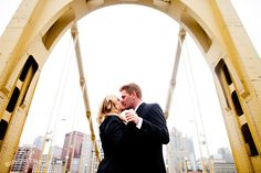 This shot really captures the essence of the couple and the city they live in.  Anyone familiar with Pittsburgh knows this bridge and the skyline-- managing to fit the couple, the bridge and the city into one photo is artful.