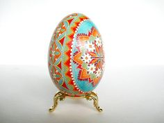 Turquoise and Orange Goose Egg Green  by UkrainianEasterEggs  I have to have my mother make me an egg in these colors.