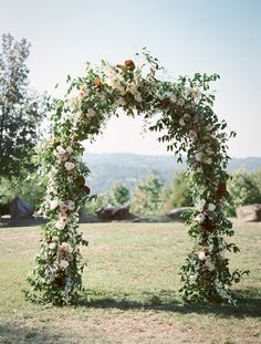 Floral Arch | Holly Carlisle Photography| Rosegolden (Amaryllis, roses, orchids)