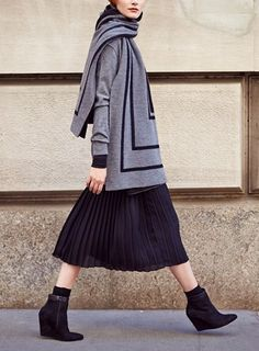 Pleats and oversized scarves are trending for fall.
