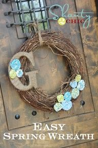 A grapvine wreath can be embellished quickly (and easily!) to add a hint of spring to your front door.  Theres a tutorial for the rosette flowers, too!