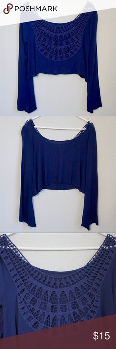 """LF Emma & Sam Bell Sleeve Crop Top LF Emma & Sam Bell Sleeve Crop Top Color: Navy Blue Size: Small Condition: Pre-Owned; Excellent Measurements: Shoulder to Hem 17"""" Features: This adorable crop top has crochet details in the back. The tag was cut out so it would not be seen through the crochet when worn. LF Tops Crop Tops"""