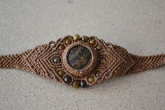 Hey, I found this really awesome Etsy listing at https://www.etsy.com/listing/124653175/brown-macrame-bracelet-brown-black-onyx