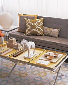 Genius DIY Idea: army cot converted to a coffee table with spray painted trays. Easy, re-purposed, utilitarian.