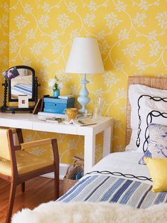 Love the bright yellow wallpaper and of course, the parsons desk.