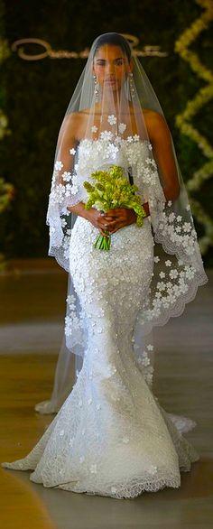 Oscar De La Renta. I really dont like weddings...but I love this dress!!!!
