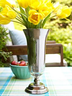Mercury Glass Finish; spritz some water inside a vase some will bead and run down the inside the vase. While the vase's interior is still wet, spray it with a coat of Krylon Looking Glass spray paint. Let dry and spray another coat. Very simple and cute!
