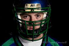Alex Football Helmet Senior Photo.  2014 Doherty High School Senior, Alex, sports his football helmet, in this photo from his Senior Portrait Session.  Colorado Springs Senior Photography.  www.LMJCreative.com