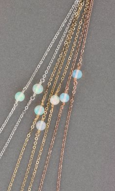 Delicate Opal Necklace: a Natural, Genuine Opal is suspended on dainty chain. A timeless, classic in 14k Gold Fill, Sterling Silver or Rose Gold Fill. Beautiful alone for elegant simplicity or use it as a versatile layering piece! Necklace: DAINTY OPAL LINK - GENUINE Opal (4mm) - Top Quality USA or Italian made chain and findings - All components are 100% sterling silver, 14k gold filled or rose gold filled. - Handmade in a happy Pacific NorthWest studio! - Comes in a cute little package…
