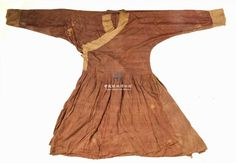 Edge silk brocade gown Level two relics  Times element  number one  texture silk  red color  Size (cm) Length: 114 Width: Bust: 53 through sleeve: 164  Description This piece gown shape right of junction, cross collar, narrow sleeves, the whole gown with brown silk as the main fabric, cuffs and collar are decorated with brocade edge. This dress collection from Qinghai folk.