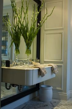 House & Home: Julie Charboneau -  Glam bathroom with marble top floating sink mounted to glossy ebony ...