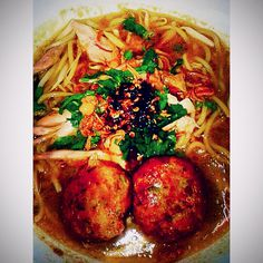 Braised chicken soup with yellow noodles and handmade potato beef cutlets simply known as Mee Soto & Bagedil.