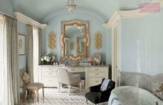 notice the crown moulding against the vaulted ceiling...the blue is a lovely choice
