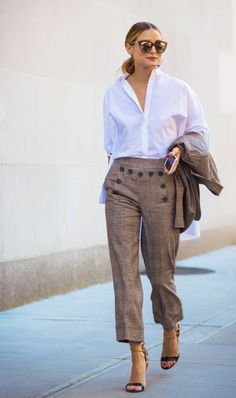Styling cropped plaid pants with lighter neutrals.