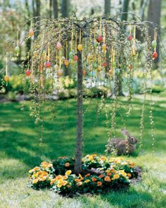 Colorful Egg Tree  Every passerby, including a wayfaring rabbit, stops to admire this weeping cherry tree. With bright marbleized eggs suspended on yellow ribbons and a ring of golden pot marigolds around the base, it sets the stage for a lively egg hunt or leisurely spring brunch.