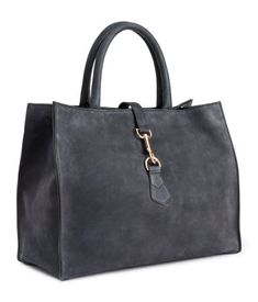 Handbag in thick, dark grey, brushed leather with two handles, detachable shoulder strap, zip, and metal buckle at top. | H&M Accessories