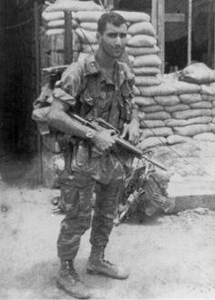 LRRP laden with gear and his CAR-15 - Vietnam war