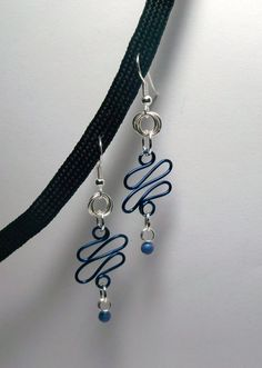 Blue wire with Blue beads Earrings $11.50