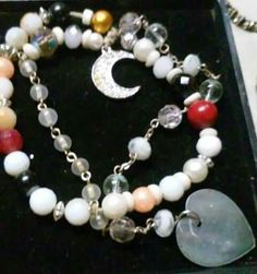 Magick enhancement bracelet. Pearl, carnelian red Jasper, silver charms, and white agate. $65