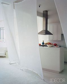 Stretched theatrical scrim used to screen an open kitchen from the living area of a Manhattan loft.