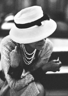 coco gabrielle chanel photos - Coco Chanel in hat and pearls.jpg