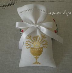uploaded this image to 'punto croce'. See the album on Photobucket. Première Communion, First Communion, Crochet Placemats, Catholic Crafts, Crochet Sandals, Lavender Bags, Simple Cross Stitch, Party Bags, Gifts For Friends