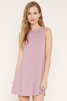 In a micro-ribbed knit, this sleeveless shift dress features a V-cutout back and a scoop neckline.