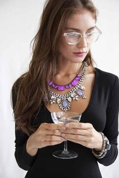 digging those clear fashion-forward, artsy glasses...and her statement necklaces are perfect for that top.