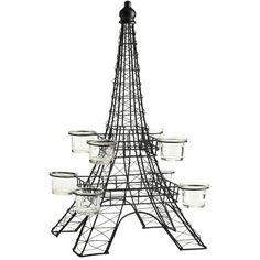 This striking tea light holder pays homage to the iconic Paris landmark. Handcrafted Eiffel Tower shape with 8 glass tea light holders would make a distinctive mantel or table accent. Paris Prom Theme, Parisian Wedding Theme, Paris Party, Candles And Candleholders, Candle Centerpieces, Glass Candle Holders, Centerpiece Ideas, Candle Stands, Tour Eiffel