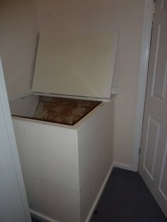 Before: Box room, cupboard over stairs