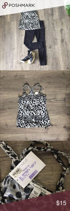 American Rag tank top size medium Animal print American Rag tank top, size medium. This shirt is new with a Macy's tag still attached. It has a drawstring at the bottom of the shirt, and stylish braided detail around the neck. This cute tank top goes well with just about any outfit! Measurements are included in the pictures, but let me know if you need more information. All offers are considered! American Rag Tops Tank Tops