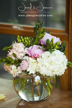 Centerpieces Shannon's Custom Florals for rounds tables