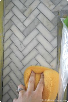 You can do your own tiled mantle! Great blog article with step-by-step instruction with images.