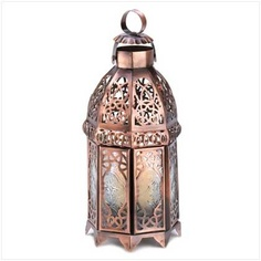 DSHD Copper Moroccan Candle Lamp  Intricate swirls of gleaming copper add luster to this dramatic candle lantern, imparting the feel of a timeless treasure. Unique double-door design is sure to add a faraway flair to any surroundings!