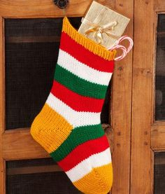Knitting Patterns Christmas Striped Holiday Stocking Free Knitting Pattern from Red Heart Yarns Knitted Christmas Stocking Patterns, Knitted Christmas Stockings, Christmas Patterns, Diy Christmas, Crochet Christmas, Christmas Things, Country Christmas, Knitting Patterns Free, Free Knitting