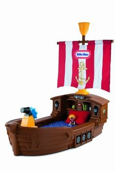 Little Tikes Pirate Ship Toddler Bed (050743625954) Durable themed toddler bed Includes ship's wheel Built in toy box with removable lid for toy storage Headboard cubby holes for clock and books Includes Working night lights