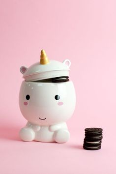 Elodie is the guardian of your goodies, the protector of your pastries, the defender of your desserts…You get the idea. Stash your next batch of extra chocolate chocolate chips in this cute ceramic cookie jar featuring Elodie and her signature pastel mane and magical golden horn. You might even call it a sweet idea. #Elodie #Unicorn #Cookies #Yum! #JunkFood #Kawaii #KitchenGoodies